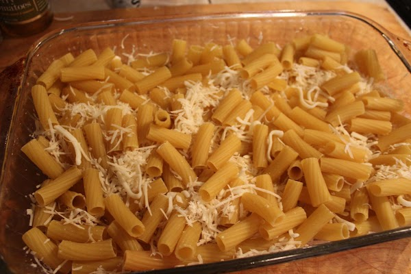 Add pasta, mozzarella, and Parmesan cheeses.