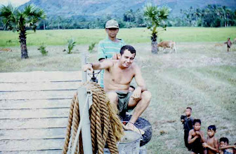 Photo: Twitty getting massage by our Chief Boy somewhere near Cambodia