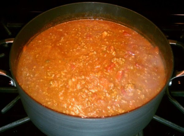 Pour in beef broth, pinto beans, diced tomatoes, tomato sauce, tomato paste, cider vinegar...