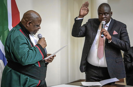 Deputy minister of home affairs Njabulo Nzuza being sworn in by deputy chief justice Raymond Zondo. Nzuza has tested positive for Covid-19. File photo.