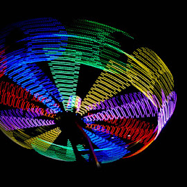 Fair ground wheel spinning by Andrew Lancaster - Abstract Light Painting ( beautiful, fast, beauty, light, painting, night, spinning, fair, fairground, ride, colours )