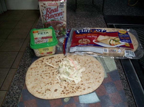place your wraps on a flat surface and place one scoop full of coleslaw...