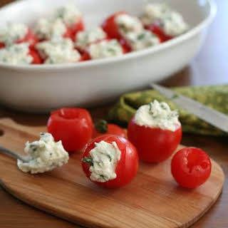 Cherry Tomatoes Stuffed With Goat Cheese and Herbs.