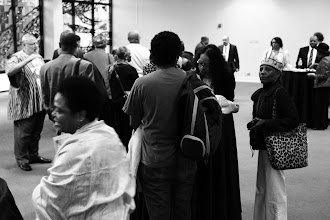 Photo: Students, faculty and members of the community mingling over refreshments at the end of the service.