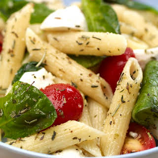Penne Pasta Salad with Spinach and Tomatoes.