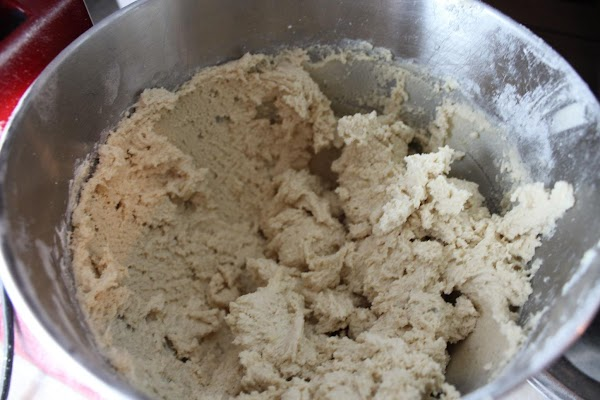 Flour blended into almond mixture to form dough.