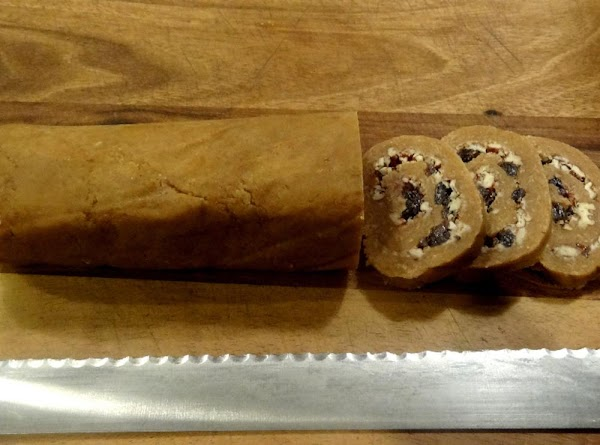 Pre-heat the oven to 325 degrees. Place the chilled log on the cutting board....