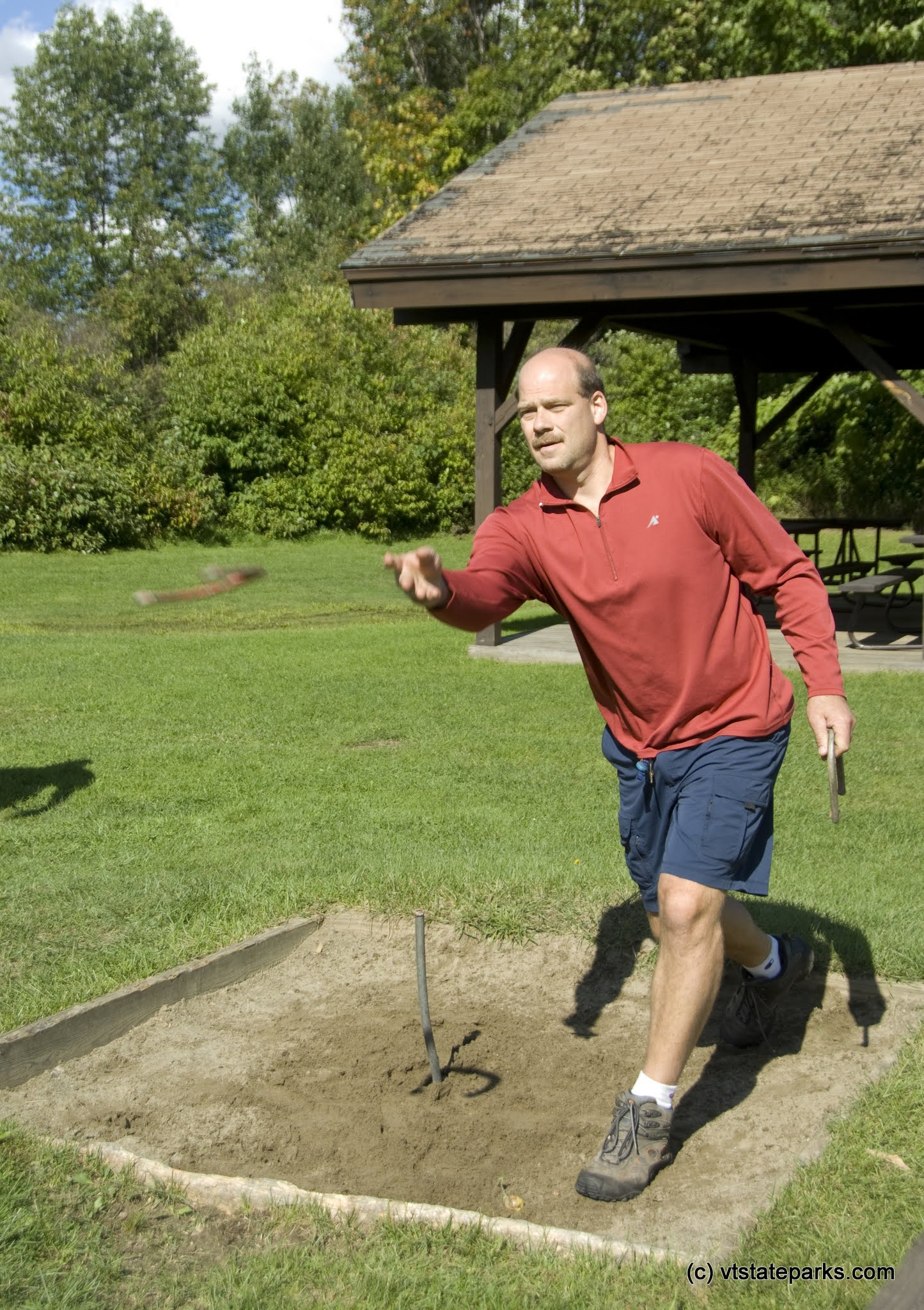 Photo: Eugene Dambach of Elmore plays horseshoes at the Morristown Rescue Squad picnic at Elmore State Park. Photo by Karen Pike