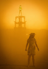 Photo: A ranger stands guard in front of the Burning Man tower during a sandstorm on the evening of the burn. - from Trey Ratcliff at www.stuckincustoms.com
