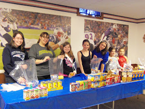 Photo: Joanne, Vici, Ava, Kylee, Mia, Chloe & Emily Packing Kare Kits on April 21,2013 for United Way's Star Project Competition.