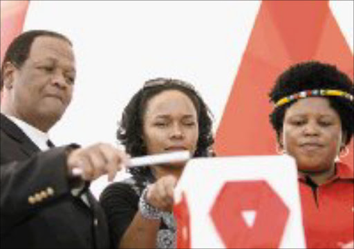 BRAVE FACE: HIV positive Siphokazi Redman, 34, flanked by acting Minister of Health Jeff Radebe and MEC for health in KwaZulu-Natal Peggy Nkonyeni speaks at the international candlelight ceremony in Durban yesterday. Pic. Mandla Mkhize. © Sowetan.