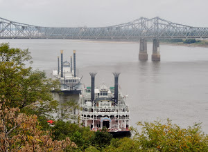 Photo: American Queen Paddle Wheeler that offers cruises on the Mississppi River from New Orleans LA to Natchez MS to St Louis MO and the Isle a Capri Casino permanently docked behind it