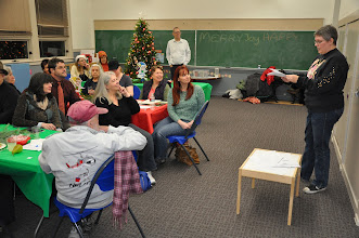 """Photo: Vonny reading to the RASP audience in our """"Read or Yoink"""" poetry game. Thanks to Michael (standing at the back) for organizing this activity."""