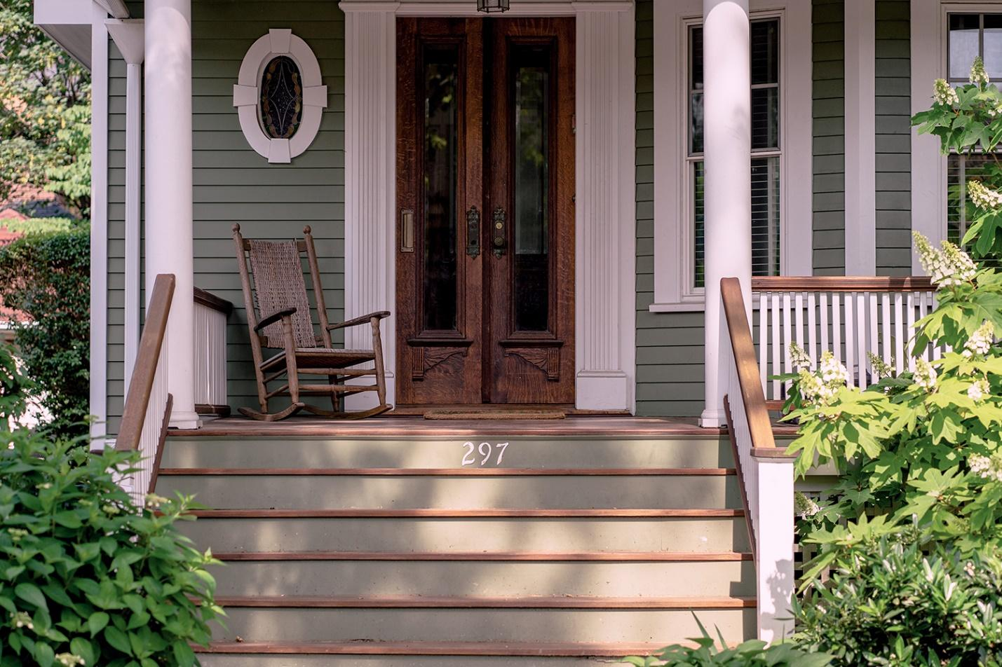 Rocking chair on a front porch.