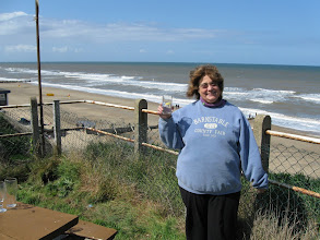 Photo: Barbara enjoying a gin and tonic (the Brits are skimpy with ice) at Mundesley Beach.