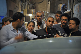 Photo: Ahmad Abdalla with the film star Asser Yassin, DOP: Tarek Hefny & Co-producer: Omar Sham On the set of Rags & Tatters - Cairo 2013