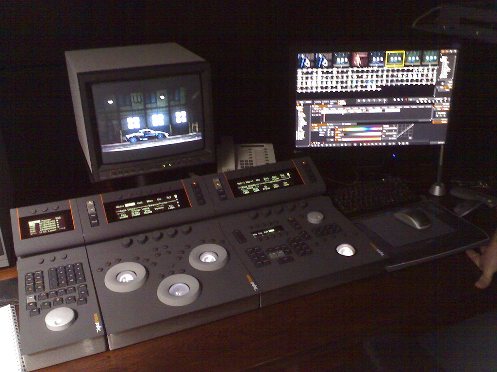 An old video editing control panel with a number of knobs and buttons to interface with the software
