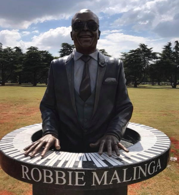 robbie malingas family is happy with his redesigned tombstone