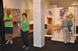 Photo: Viewing more exhibits: Roy Kindelberger, Ida Freilinger, and Johnny BaranskI (facing away).