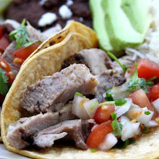 Garlic Studded Slow Cooker Carnitas Tacos