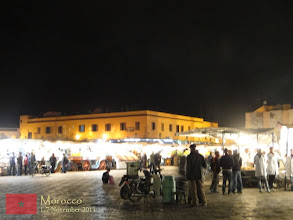 Photo: as darkness falls, Djemaa El-Fna fills with dozens of food-stalls as the number of people on the square peaks