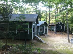 Photo: Midget cabins. NPC/Cast Housing in Cottington Woods.