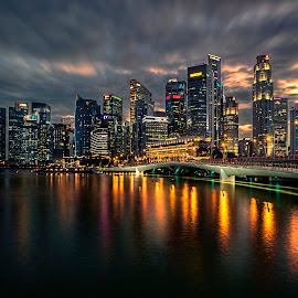 Dusk @ Shenton Way by Gordon Koh - City,  Street & Park  Skylines ( shenton way, clouds, skyline, reflection, riverfront, cityscape, singapore, lights, urban, fiery, cbd, skyscraper, sunset, dramatic, asia, night, jubilee bridge, waterfront )