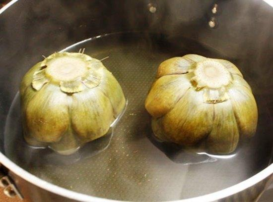 In large stock pot, soak artichokes in salt water for 20 minutes to tenderize...