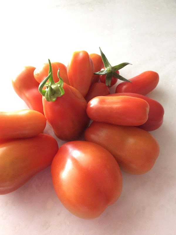 Wash tomatoes and take off stems  Boil in water until the skin starts to...