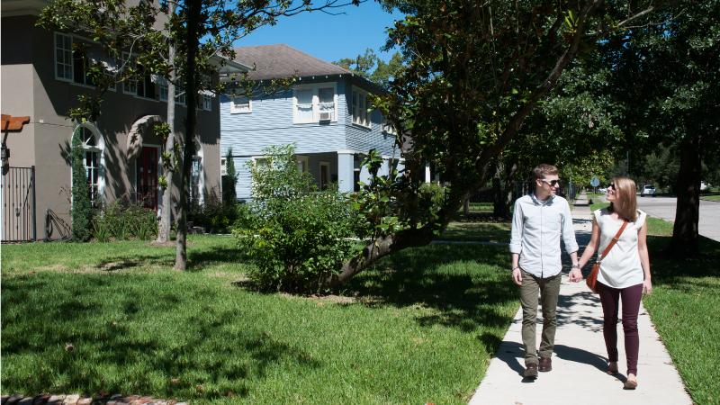 A couple walks through The Heights neighborhood in San Antonio.