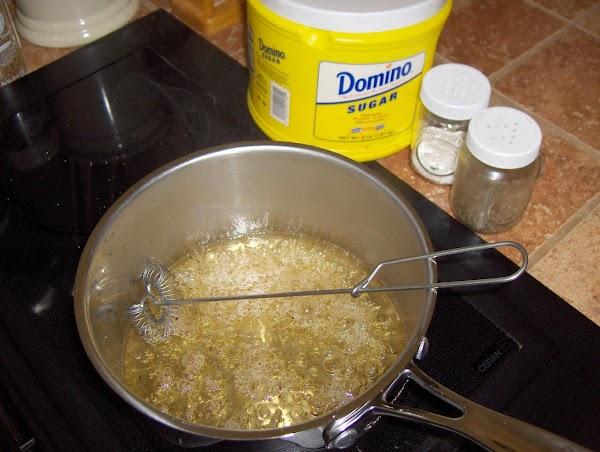 n a small sauce pan, heat the vinegar, salad oil, sugar, salt, pepper, ...