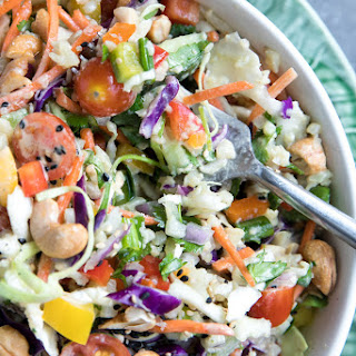 Thai Cashew Coconut Cauliflower Rice Chopped Salad with Ginger Peanut Dressing.