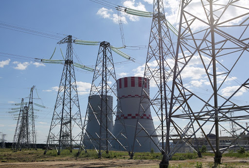 Pylons carry electricity power lines past cooling towers at the Novovoronezh NPP-2 nuclear power station, operated by OAO Rosenergoatom, a unit of Rosatom, in Novovoronezh, Russia. Picture: BLOOMBERG
