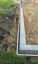 Photo: Irrigation line on outside of curb 08-05-2014