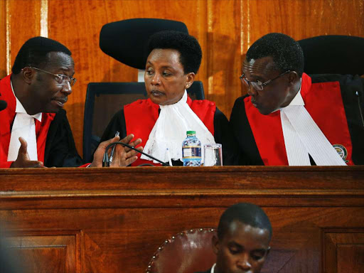 Chief Justice David Maraga consults Deputy Philomena Mwilu and justice Smokin Wanjala during the status conference of the presidential election petition, November 14, 2017.