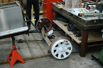 Photo: Another photo of the rear axle removed from the CBL. Note there are only 4 bolts holding the wheel to the axle, even though there are 8 holes.