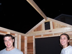 Photo: I took this picture right after we hung the ridge beam between the gabled ends. Aren't Joe and Lauren cute?