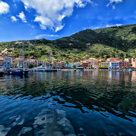 Isola del giglio (Tuscany, Italy) by Gianluca Presto - City,  Street & Park  Vistas ( giglio porto, harbour, reflection, tuscany, isoladelgiglio, clouds, water, home, water reflection, houses, hills, homes, village, italy )