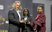 Smangele Hadebe receives BSA's Female Prospect of the Year Award from Arnold Schwarzenegger and BSA board member  Matilda Kabini.