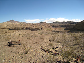 Photo: A broader view of the abandoned motorcycle and a few of the many car parts littered around.