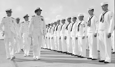 Photo: Capt. Duffy holds his final review of the men of Chase Field before he's relieved as Commanding Officer by CDR F.O. Green