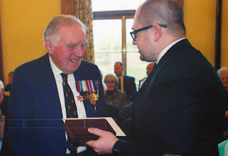Photo: Presentation of the Ushakov Medal to Flotilla member Cdr Harold Lloyd of Dartmouth by Russian Embassy Counsellor Sergey Nalobin at a ceremony in County Hall, Exeter, on 19 December 2014, in recognition of his World War 2 service in Arctic Convoys.