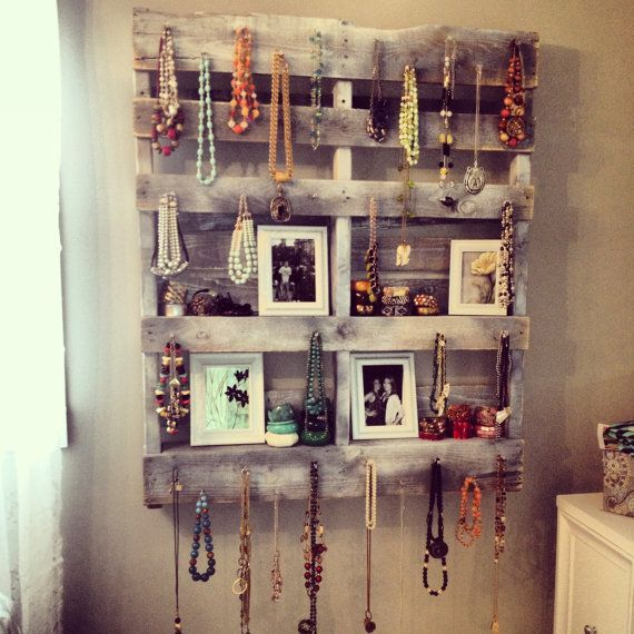 A recycled pallet can pull double duty as shelves and jewelry display!