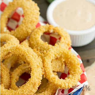 Oven Fried Onion Rings With Copycat Outback Blooming Onion Dipping Sauce.