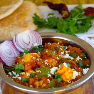 Kadhai Paneer- Cottage Cheese Sauteed in Tomato base with aromatic Indian spices.