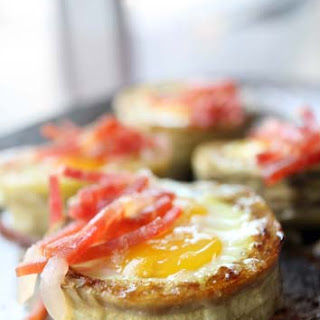 Artichokes with quail eggs and Spanish cured ham.