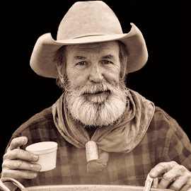 Chow's Ready; Come and Get It by Judy Rosanno - Black & White Portraits & People ( cowboy, event, february 2018, san antonio stock show and rodeo, chuckwagon cook, soup, smoky )