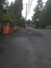 Photo: Standing at the east end of the sidewalk at 7th Ave NE, looking west along NE 115th St toward 5th Ave NE.