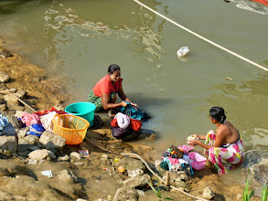 Photo: Women do their laundry in the Irrawaddy River by our hotel. This is where we later left for a boat ride.