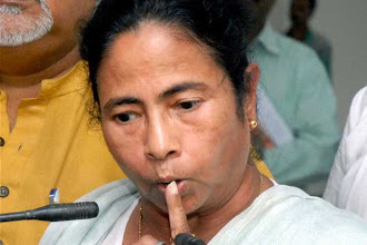 Photo: WB: Don't play with fire, Mamata warns opponents http://t.in.com/9ruS
